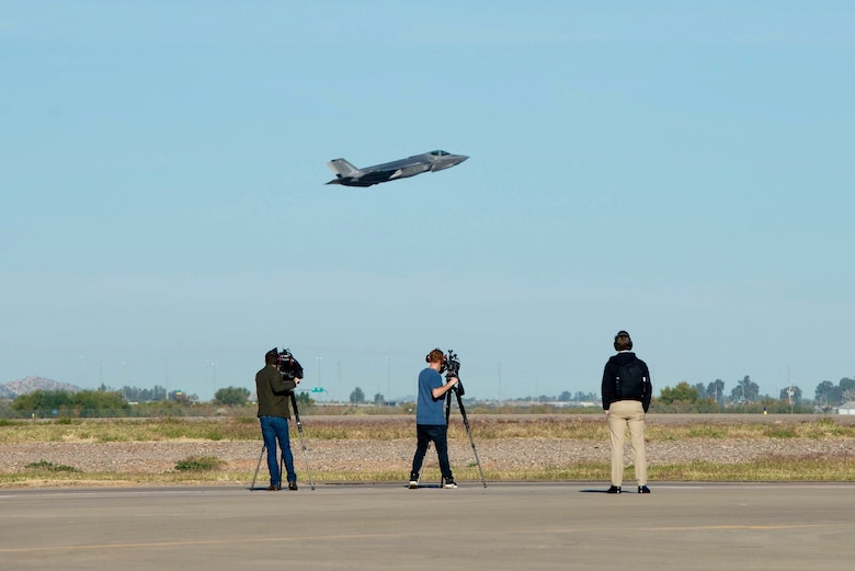 Australian media correspondents film a Royal Australian Air Force F-35A Lightning II take off at Luke AFB Ariz., Nov. 27, 2018. Four media members interviewed RAAF Airmen in preparation for the first two RAAF F-35s to arrive in Australia. (U.S. Air Force photo by Staff Sgt. Jensen Stidham)