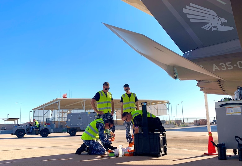 Royal Australian Air Force prepare to perform routine maintenance on an F-35A Lightning II take at Luke AFB Ariz., Nov. 28, 2018. Once completing maintenance, RAAF Airmen have been performing additional tasks over the past two months in preparation to send their first two RAAF F-35s to Australia. (U.S. Air Force photo by Staff Sgt. Jensen Stidham)