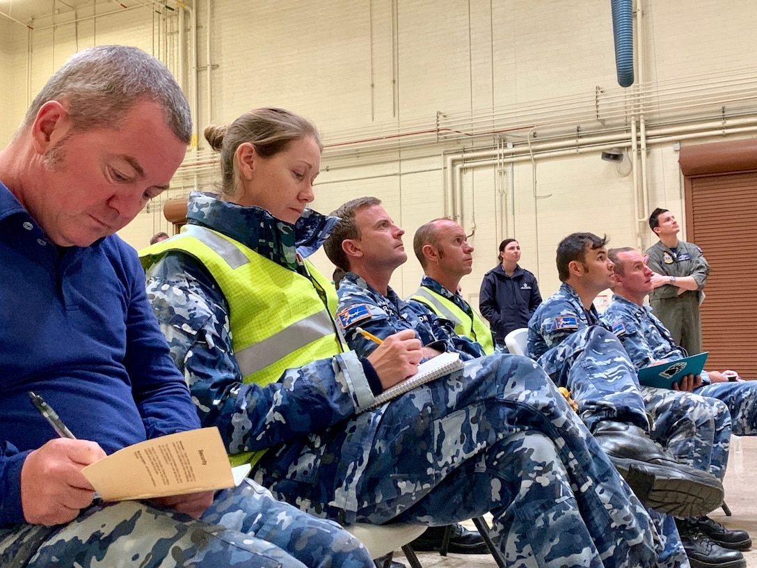 Royal Australian Air Force listen to a briefing at Luke AFB Ariz., Nov. 28, 2018. The RAAF has been preparing to send their first two RAAF F-35s to Australia. (U.S. Air Force photo by Staff Sgt. Jensen Stidham)