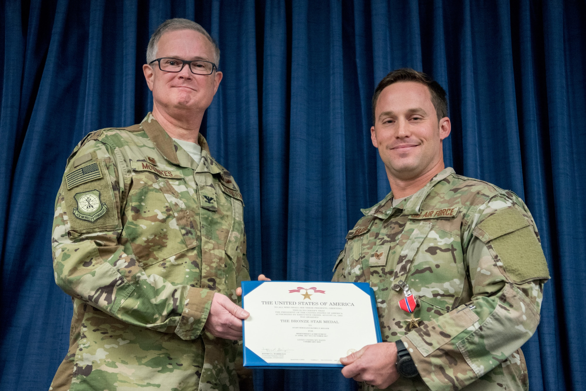 Staff Sgt. Daniel P. Keller (right), a combat controller for the 123rd Special Tactics Squadron, receives the Bronze Star Medal from Col. David Mounkes, commander of the 123rd Airlift Wing, during a ceremony at the Kentucky Air National Guard Base in Louisville, Ky., Nov. 17, 2018. Keller distinguished himself in 2017 for meritorious service in Eastern Afghanistan. His performance resulted in seven medical evacuations of American and partner forces, 209 enemies killed in action, 11 enemies wounded in action, and 163 defensive fighting positions destroyed. (U.S. Air National Guard photo by Staff Sgt. Joshua Horton)