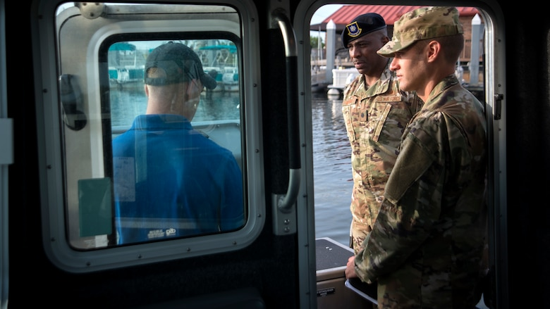 U.S. Air Force Col. Stephen Snelson, 6th Air Mobility Wing Commander, and Lt. Col. Robert Moore, 6th Security Forces Squadron Commander, talk with Tech. Sgt. James Himes, the NCO in charge of the 6th SFS Marine Patrol, at MacDill Air Force Base, Fla., Nov. 26, 2018.