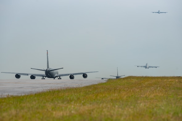 A four-ship of KC-135 Stratotankers from the 909th Air Refueling Squadron depart Kadena Air Base, Japan, Nov. 2, 2018, during exercise Steel Tiger. The aircrew used one runway to conduct minimum interval take-offs between departures. The 909th ARS is the first KC-135 unit in the Pacific Air Forces to train on this procedure. (U.S. Air Force photo by Staff Sgt. Micaiah Anthony)