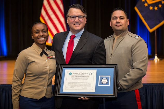 "David DiEugenio, the chief information officer and assistant chief of staff, G-6 at the Marine Corps Recruiting Command, poses for a photo with coworkers Capt. Shari Peters and Capt. Mike Castaneda, during the Department of Defense CIO Annual Awards ceremony at the Pentagon in the District of Columbia, Nov. 29, 2018. DiEugenio received this annual award for his exceptional achievements in delivering forward-leaning and strategically impactful technology capabilities and information technology management practices. ""While my name happens to be on the award, it's really a reflection of the individual and collective efforts of the team,"" DiEugenio said. ""We have folks spread across the nation who are pulling on the same oar and helping us move in a positive direction. Any credit for our success belongs to them."" (Marine Corps photo by LCpl. Naomi May)"