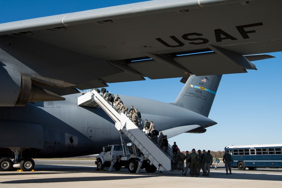 Aircraft maintainers assigned to the 512th Airlift Wing board a 436th AW C-5M Super Galaxy aircraft Nov. 23, 2018, at Dover Air Force Base, Del. More than 30 Citizen Airmen and the aircraft left for Ramstein Air Base, Germany, to provide hands-on, C-5-specific training for 521st Air Mobility Operations Wing maintainers from nearly 20 different geographically separated units located throughout Europe and the Middle East. (U.S. Air Force photo by Staff Sgt. Aaron J. Jenne)