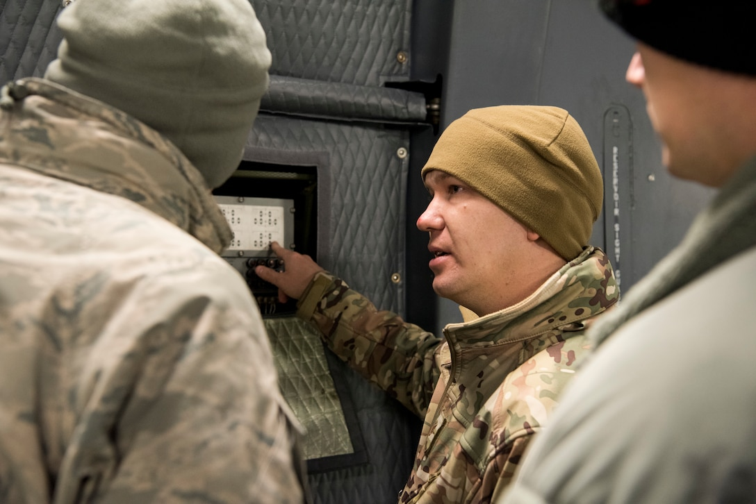 Staff Sgt. Brett Anger, 521st Air Mobility Operations Wing regional training center electrical environmental systems instructor, explains the anti-skid test controller to students aboard a C-5M Super Galaxy aircraft at Ramstein Air Base, Germany, Nov. 29, 2018. Nearly 60 aircraft maintainers and 30 aerial port personnel trained on the aircraft, assigned to the 436th Airlift Wing in Dover, Del., during a first-of-its-kind training session held Nov. 26 – Dec. 7. (U.S. Air Force photo by Staff Sgt. Aaron J. Jenne)