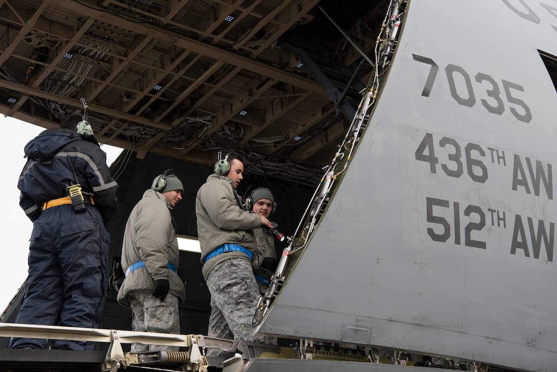 "Staff Sgt. Ryan Johnson (front right), 521st Air Mobility Operations Wing regional training center crew chief instructor, shows students what they need to inspect aboard a C-5M Super Galaxy aircraft at Ramstein Air Base, Germany, Nov. 29, 2018. The 521st AMOW's mission, to ""expedite global reach to professionally answer our Nation's call,"" relies heavily on skilled aircraft maintainers who ensure transient aircraft get the maintenance they need en route. (U.S. Air Force photo by Staff Sgt. Aaron J. Jenne)"