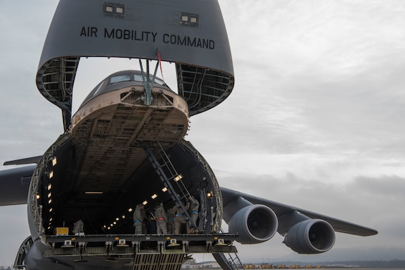 Airmen assigned to the 521st Air Mobility Operations Wing headquartered at Ramstein Air Base, Germany, learn how to operate and maintain a ramp aboard a C-5M Super Galaxy aircraft at Ramstein AB, Nov. 29, 2018. The 521st AMOW has more than 2,100 personnel spread out across nearly 20 geographically separated units throughout Europe and the Middle East. (U.S. Air Force photo by Staff Sgt. Aaron J. Jenne)