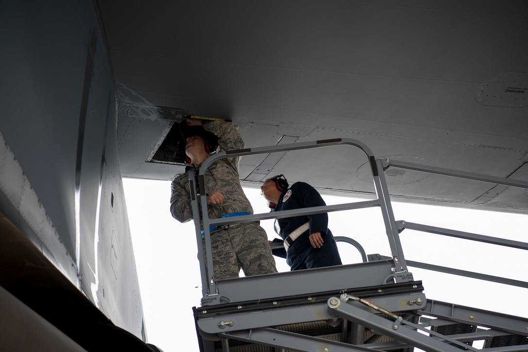 Master Sgt. Jeff Bejune, 512th Aircraft Maintenance Squadron C-17 hydraulic systems specialist, and Senior Airman Lourdes Cigarruista, 512th Maintenance Squadron C-5 hydraulic systems specialist, from Dover Air Force Base, Del., look for a hydraulic leak on a C-5M Super Galaxy at Ramstein Air Base, Germany, Nov. 29, 2018. More than 30 U.S. Air Force Reserve aircraft maintainers assigned to the 512th Airlift Wing augmented flight line maintenance operations for two weeks during a first-of-its-kind C-5 training session at Ramstein AB. (U.S. Air Force photo by Staff Sgt. Aaron J. Jenne)