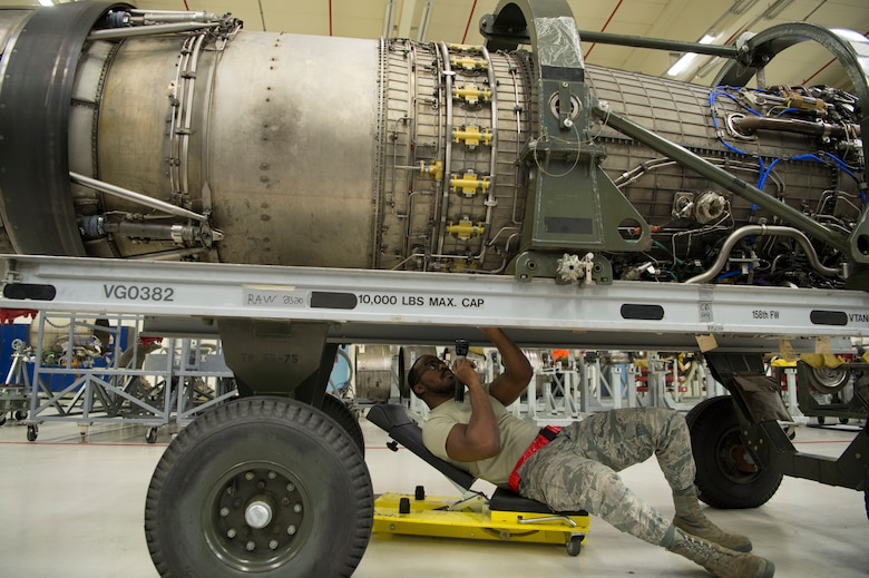 An F-16 engine is made up of different parts that are worked on by different sections in MXS then combined after completely being fixed.