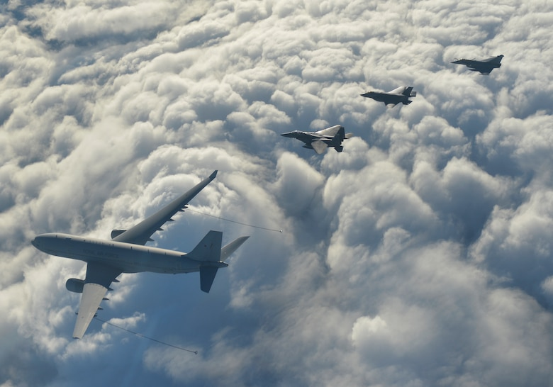 A U.S. Air Force F-15E Strike Eagle from RAF Lakenheath, a Royal Air Force Voyager from RAF Brize Norton, a RAF F-35B Lightning II from RAF Marham and a French Air Force Rafale