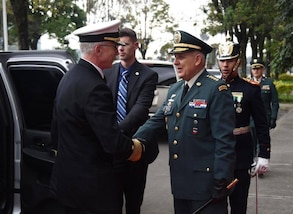 Navy. Adm. Craig S. Faller, commander of U.S. Southern Command, is greeted by Colombian Chief of Defense Alberto Jose Mejia in Bogota.