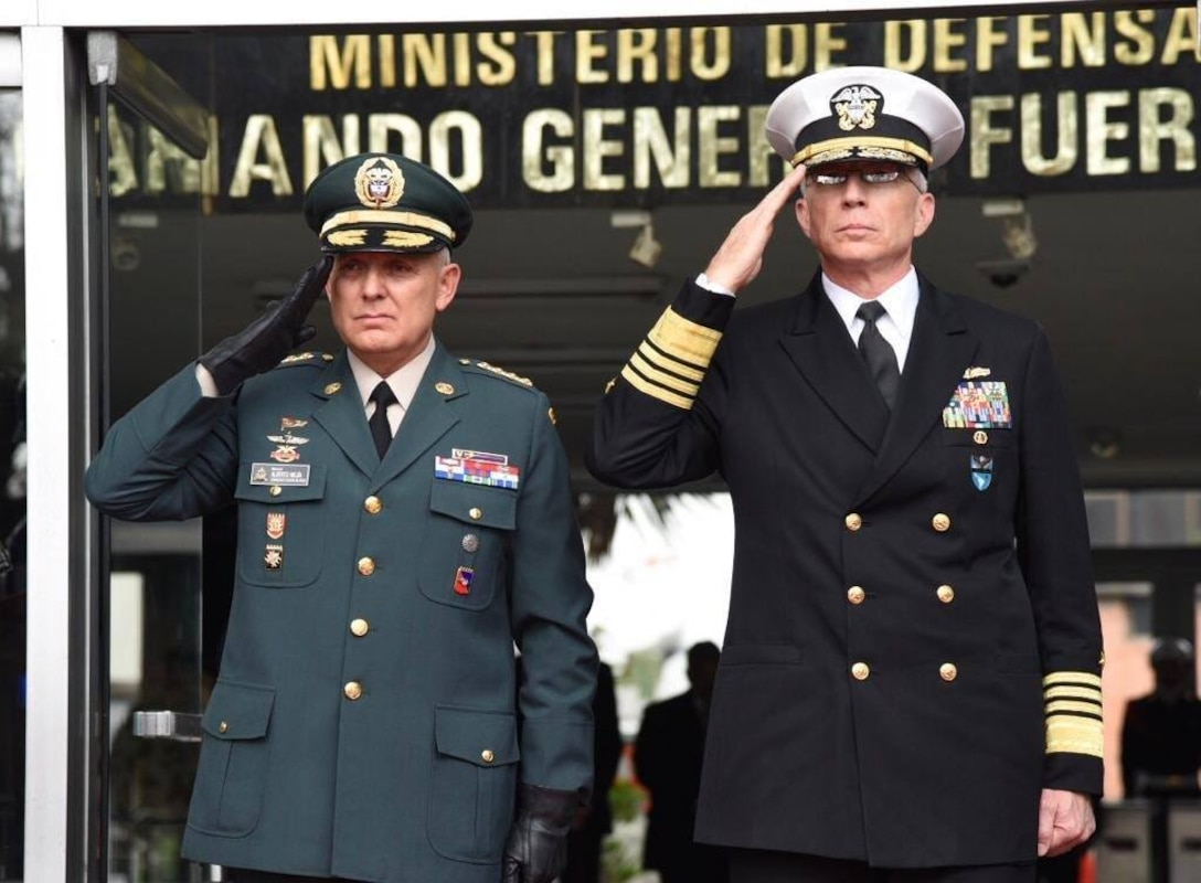 Navy. Adm. Craig S. Faller, commander of U.S. Southern Command, and Colombian Chief of Defense Alberto Jose Mejia render honors in Bogota.