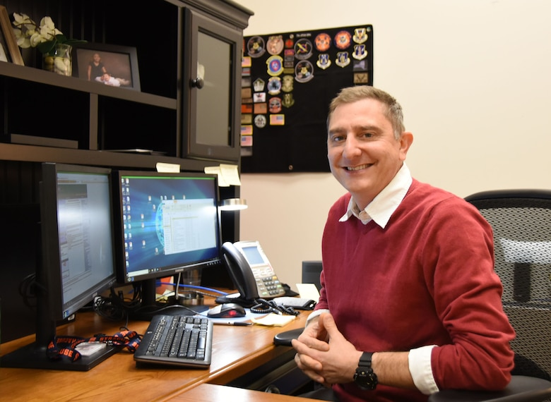 Mike Pettinelli, the director of psychological health with the 118th Wing, poses for a photo at his desk on Nov. 28, 2018 at Berry Field Air National Guard Base in Nashville, Tennessee.