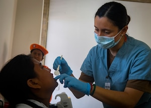 Honduran army Lt. Stephanie Arriaga, from Tegucigalpa, Honduras, conducts a dental exam for a patient at one of two medical sites.