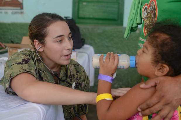RIOHACHA, Colombia (Nov. 28, 2018) – Ensign Abigail Howard, from Rochester, N.Y., checks a patient's heartrate at one of two medical sites. The hospital ship USNS Comfort (T-AH 20) is on an 11-week medical support mission to Central and South America as part of U.S. Southern Command's Enduring Promise initiative.