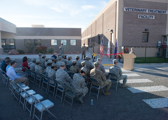 Base leadership, distinguished visitors and veterinary treatment facility staff cut the ribbon to signify the opening of the facility on Nellis Air Force Base, Nev., Nov. 14, 2018. The new facility is 3,600 square feet, which is twice the size of the previous facility. (U.S. Air Force photo by Airman 1st Class Bryan T. Guthrie)