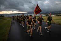 U.S. Marines with Combat Assault Company (CAC), 3rd Marine Regiment, conduct a motived run on Marine Corps Base Hawaii, Nov. 27, 2018. CAC held the run to commemorate the retirement of Master Gunnery Sgt. John Kelsch, the engineer chief for U.S. Marine Corps Forces, Pacific. (U.S. Marine Corps photo by Sgt. Jesus Sepulveda Torres)