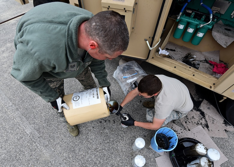 Tech. Sgt. Brock Hursey, left, and Airman 1st Class Thomas Carrico, both supporting the 325th Civil Engineer Squadron, top off oil filters prior to installing them on a BPU 800 kilowatt high-voltage generator Nov. 30, 2018, at Tyndall Air Force Base, Fla. In the wake of Hurricane Michael, support and supplies from around the country poured in to assist Tyndall in recovery efforts. (U.S. Air Force photo by Senior Airman Isaiah J. Soliz)