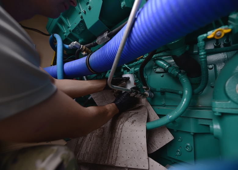 Staff Sgt. Joshua R. Olando, an electrical power production craftsman supporting the 325th Civil Engineer Squadron, installs new filters on a BPU 800 kilowatt high-voltage generator Nov. 30, 2018, at Tyndall Air Force Base, Fla. In the wake of Hurricane Michael, support and supplies from around the country poured in to assist Tyndall in recovery efforts. Olando is currently deployed from the 436th Civil Engineer Squadron at Dover Air Force Base, Del. (U.S. Air Force photo by Senior Airman Isaiah J. Soliz)