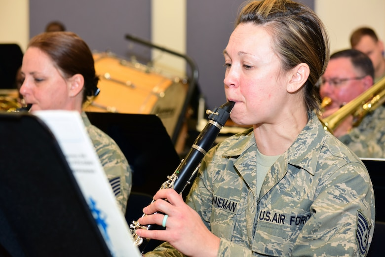 Tech. Sgt. Katie Brenneman, a clarinet player with the Air National Guard Band of the Northeast, rehearses Nov. 17, 2018, for the band's upcoming annual holiday concert. The concert band will be performing several winter and holiday-themed songs. This year's concert is scheduled for Dec. 16 at the Auditorium of the Scottish Rite Cathedral, Harrisburg, Pennsylvania, at 3 p.m. and is free to the public. (U.S. Air National Guard photo by Tech. Sgt. Claire Behney/Released)