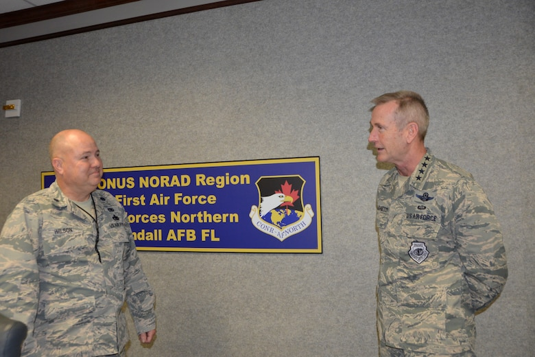 Lt. Col. Don Wilson, 1st Air Force Homecoming Center team leader deployed from the 186th Air Refueling Wing, Key Field Air National Guard Base, Meridian, Miss., discusses the center's operations with Gen. Terrence O'Shaughnessy, Commander, NORAD and U.S. Northern Command, during the general's visit to 1st Air Force facilities Nov. 27. (Air Force photo by Mary McHale)