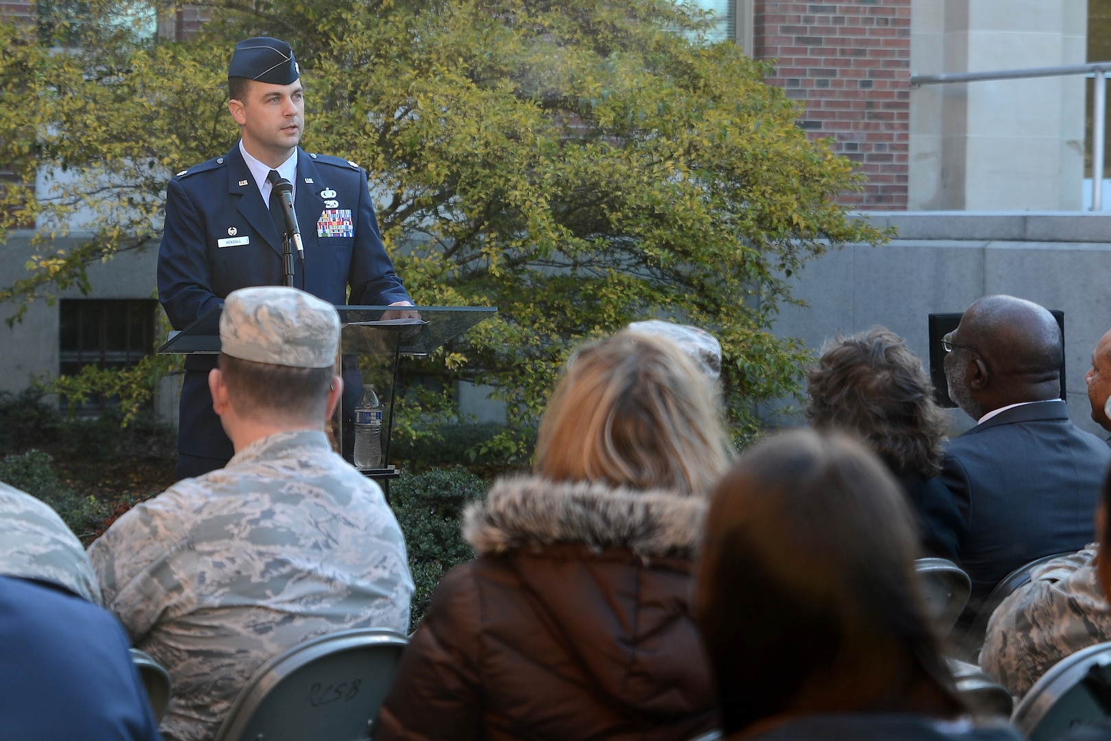 a man speaks to an audience during a ceremony