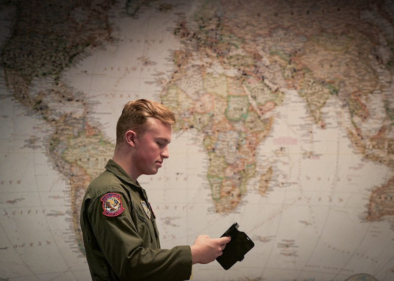 Airman 1st Class Kenyon Vickery, 15th Airlift Squadron loadmaster, checks his schedule on the squadron's new app Nov. 30, 2018, at Joint Base Charleston, S.C. The 15th AS decided to employ an innovative, modern and efficient way of relaying scheduling information to the flyers via a smartphone application.