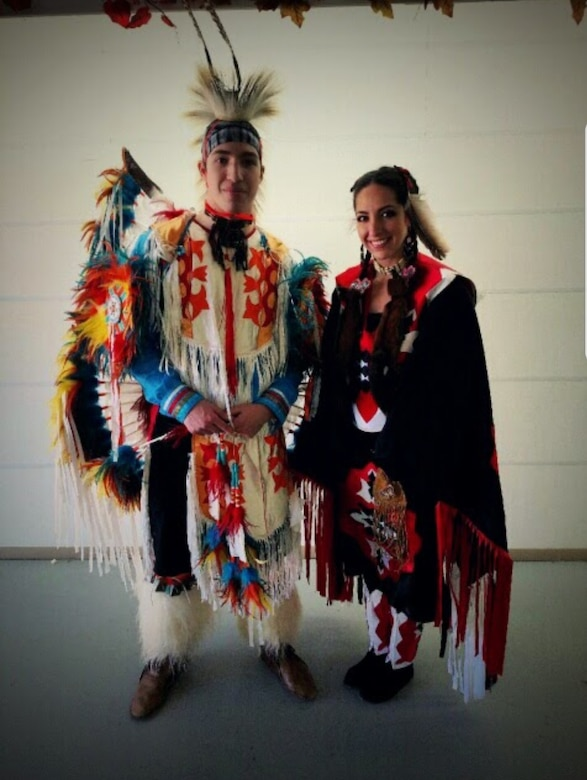 U.S. Air Force Senior Airman Taylor Walkingstick, 81st Security Forces Squadron installation patrolman, poses for a picture next to his sister, Rainye, at Fort Payne, Alabama, 2016. Walkingstick, a Native American, grew up in Alabama and has participated in many powwows with his family to share his culture. (Courtesy photo)