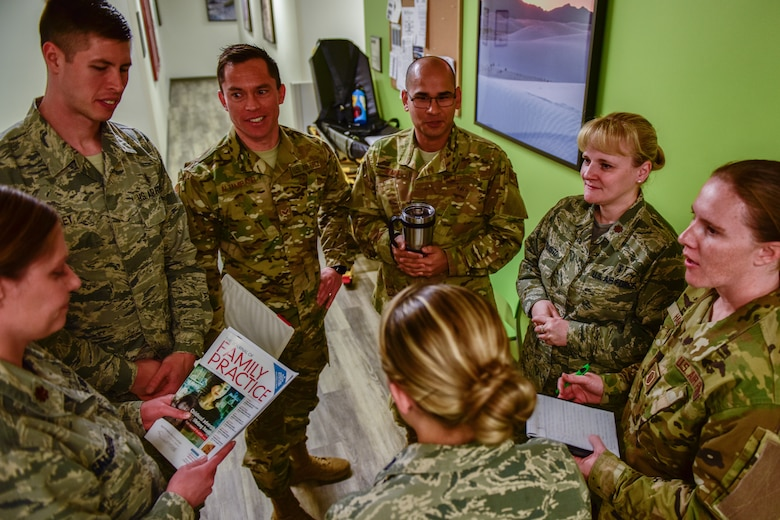 Members of the 377th Medical Operations Squadron, family health clinic, discuss the day's events during their morning huddle at the 377th Medical Group in Albuquerque, N.M., Nov. 30, 2018. The family health clinic won the yearly Air Force Global Strike Command Outstanding Medical Home Award. (U.S. Air Force photo by Airman 1st Class Austin J. Prisbrey)