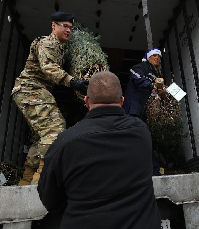 Volunteers help unload trees at Ellsworth Air Force Base, S.D., Nov. 30, 2018. Trees for Troops is an event where community members all over the country donate trees to service members so they can have a free tree for the holidays. (U.S. Air Force photo by Airman 1st Class Thomas Karol)