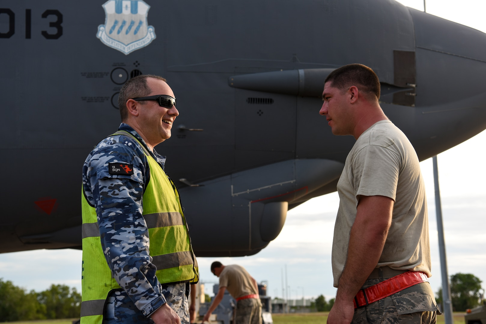 Royal Australian Air Force (RAAF) Leading Aircraftman Kevin Ewart, 13th Squadron aircraft refuler, and U.S. Air Force Staff. Sgt. Spencer Leger, 96th Expeditionary Aircraft Maintenance Unit crew chief, discuss refueling operations during exercise Lightning Focus at RAAF Base Darwin, Australia, Nov. 29, 2018.