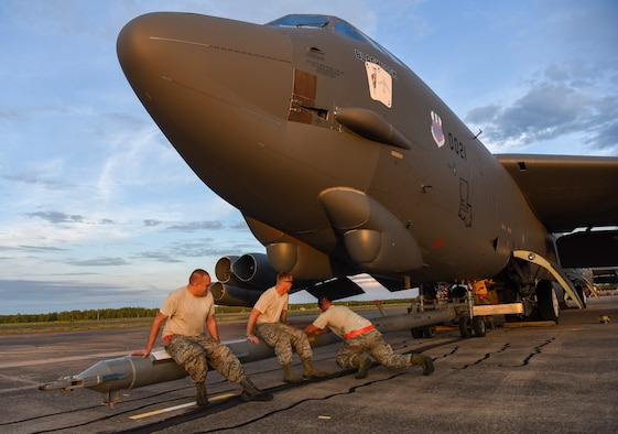 U.S. Air Force members from the 96th Expeditionary Aircraft Maintenance Unit shake a tow bar to maneuver it into place on a B-52 Stratofortress bomber during exercise Lightning Focus at Royal Australian Air Force (RAAF) Base Darwin, Australia, Nov. 29, 2018.