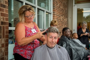 Delaware veterans receives a haircut at the 2018 Veterans' Stand Down in Dover, Delaware, Sep 21, 2018. Delaware is home to more than 78,000 veterans. (U.S. Air Force photo by Staff Sgt. Damien Taylor)