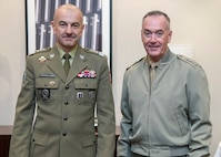 Marine Corps Gen. Joe Dunford, chairman of the Joint Chiefs of Staff, poses for a photo with Polish Lt. Gen. Rajmund Andrzejczak, chief of the general staff of the Polish Armed Forces, before a bilateral meeting in between sessions of the North Atlantic Treaty Organization (NATO) Military Committee Conference in Warsaw, Poland Sept. 29, 2018.
