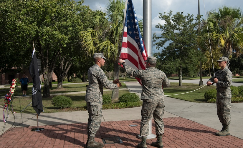 Members from Joint Base Charleston, S.C., lower the American flag during a retreat ceremony Sept. 28, 2018.