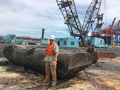 Chief of Navigation Roger Bullock stands before a pipeline dredge pontoon that was removed from the Cape Fear River on Sept. 29 by contractors who also removed two large boulders and a boat from the Wilmington Harbor. The U.S. Coast Guard reports the federal channel is free of obstructions.
