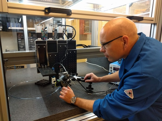 Dr. Matthew Dickerson, Laboratory University Collaboration Initiative fellow award recipient, assembles an additive manufacturing system.