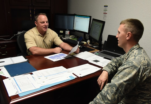 Tom Walker, 81st Comptroller Squadron deputy comptroller, and U.S. Air Force 2nd Lt. Bryan Case, 81st CPTS deputy flight commander, discuss the strategy during the fiscal year 2018 end-of-year close-out at the Sablich Center at Keesler Air Force Base, Mississippi, Sept. 27, 2018. The purpose of the close-out was to execute 100% of Keesler's funding to maximize buying power. (U.S. Air Force photo by Kemberly Groue)
