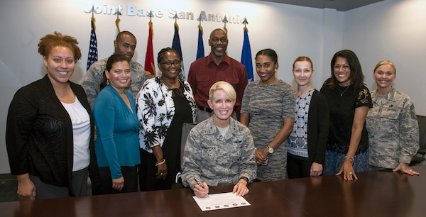 25. Joining Gen. Lenderman are (from left) are Chantelle Stoops, Family Advocacy Outreach Manager, JBSA-Lackland; Rose Padilla, Family Advocacy Program Assistance, JBSA-Lackland; Capt. Isaiah Jones, Family Advocacy Officer, JBSA-Lackland; Angela Nance Family Advocacy Intervention Specialist, JBSA-Randolph; Craig Hodge, Young Domestic Abuse Victim Advocate, JBSA; Jessica Reynolds, Family Advocacy Outreach Manager, JBSA-Fort Sam Houston; Irina Adams, Family Advocacy Intervention Specialist, JBSA-Fort Sam Houston; Stephanie Smith, Family Advocacy Officer, JBSA-Fort Sam Houston; and Chief Master Sgt. Heather Ransom, interim 502 ABW/JBSA Command Chief.