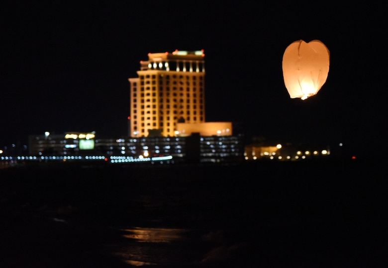 A sky lantern floats in the air during a sky lantern vigil on Biloxi Beach, Mississippi, Sept. 27, 2018. In recognition of suicide prevention and awareness month, the 81st Medical Operations Squadron mental health team hosted the themed event, Lights For Life, to honor the memories of victims of suicide. (U.S. Air Force photo by Kemberly Groue)