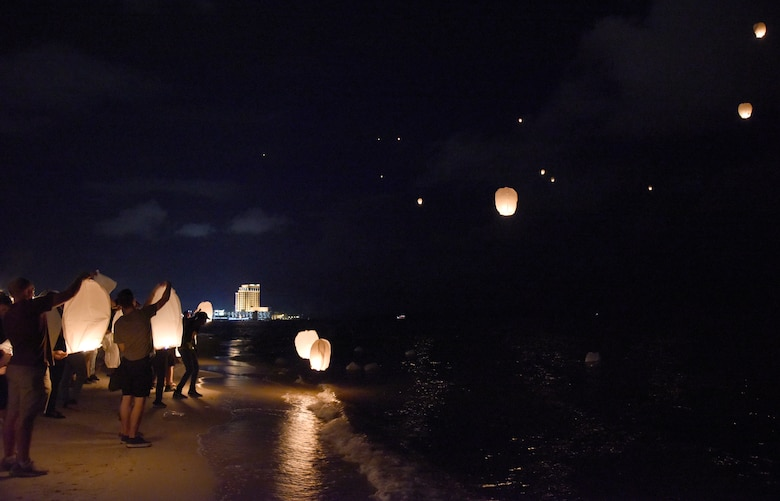 Keesler personnel and Biloxi citizens release sky lanterns during a sky lantern vigil on Biloxi Beach, Mississippi, Sept. 27, 2018. In recognition of suicide prevention and awareness month, the 81st Medical Operations Squadron mental health team hosted the themed event, Lights For Life, to honor the memories of victims of suicide. (U.S. Air Force photo by Kemberly Groue)