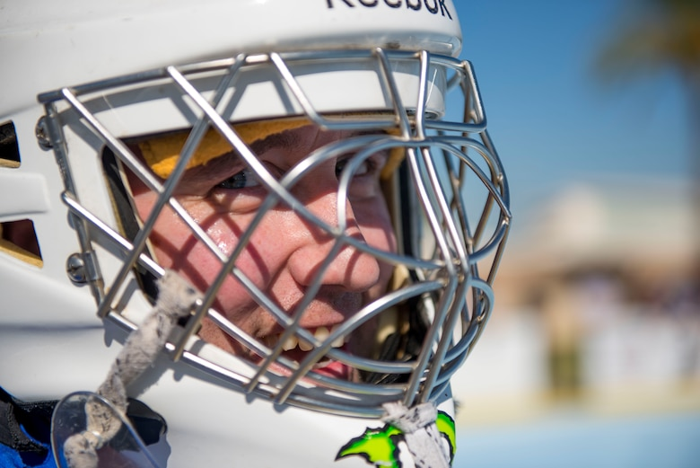 A member from the 56th Fighter Wing participates in boot hockey during the third annual Thunderbolt Cup at Luke Air Force Base, Ariz., Sept. 27, 2018.