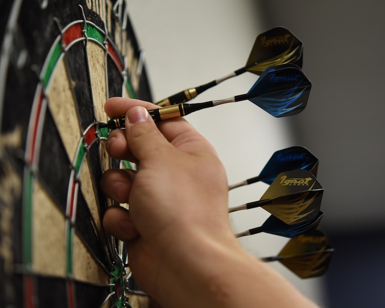 An Airmen assigned to the 56th Fighter Wing collects his darts during the third annual Thunderbolt Cup Sept. 28, 2018, at Luke Air Force Base, Ariz.