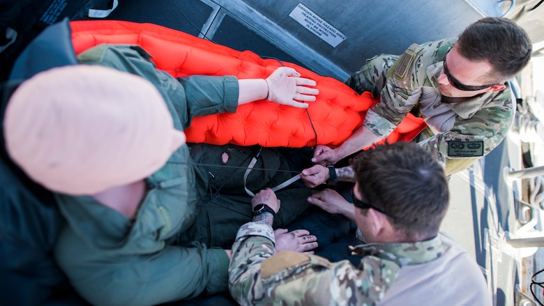 Two 27th Special Operations Support Squadron Survival, Evasion, Resistance and Escape specialists, attach a training dummy to a life raft during a full mission profile exercise at Channel Islands Harbor in Oxnard, Calif., Sept. 18, 2018. Airmen boarded a U.S. Coast Guard boat and tested search and rescue operations with cooperating aircraft. An FMP provides participants the opportunity to refine their tactics, techniques and procedures in operating in a maritime environment. (U.S. Air Force photo by Staff Sgt. Michael Washburn)