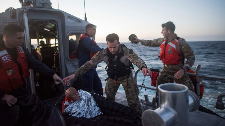 U.S. Air Force Staff Sgt. Taylor Fisher, 27th Special Operations Support Squadron Survival, Evasion, Resistance and Escape specialist, prepares a training dummy to be thrown overboard during a full mission profile exercise off the coast of Oxnard, Calif., Sept. 18, 2018. Airmen boarded a U.S. Coast Guard boat and tested search and rescue operations with cooperating aircraft. An FMP provides participants the opportunity to refine their tactics, techniques and procedures in operating in a maritime environment. (U.S. Air Force photo by Staff Sgt. Michael Washburn)