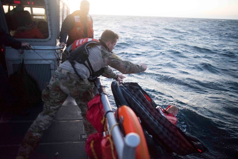 U.S. Air Force Staff Sgt. Taylor Fisher, 27th Special Operations Support Squadron Survival, Evasion, Resistance and Escape specialist, tosses a training dummy overboard during a full mission profile off the coast of Oxnard, Calif., Sept. 18, 2018. Airmen boarded a U.S. Coast Guard boat and tested search and rescue operations with cooperating aircraft. An FMP provides participants the opportunity to refine their tactics, techniques and procedures in operating in a maritime environment. (U.S. Air Force photo by Staff Sgt. Michael Washburn)