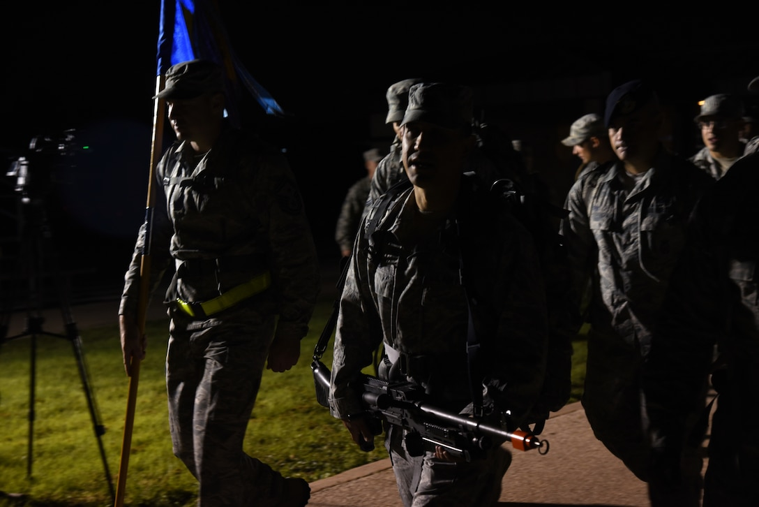 U.S. Air Force Col. Ricky Mills, 17th Training Wing commander, leads the Airman 1st Class Jacobson Memorial March at the parade field on Goodfellow Air Force Base, Texas, Sept. 28, 2018. Mills and other Airmen rucked with 21 pounds in their bag to signify the age of Airman 1st Class Elizabeth Jacobson when she was killed in action. (U.S. Air Force photo by Staff Sgt. Joshua Edwards/Released)