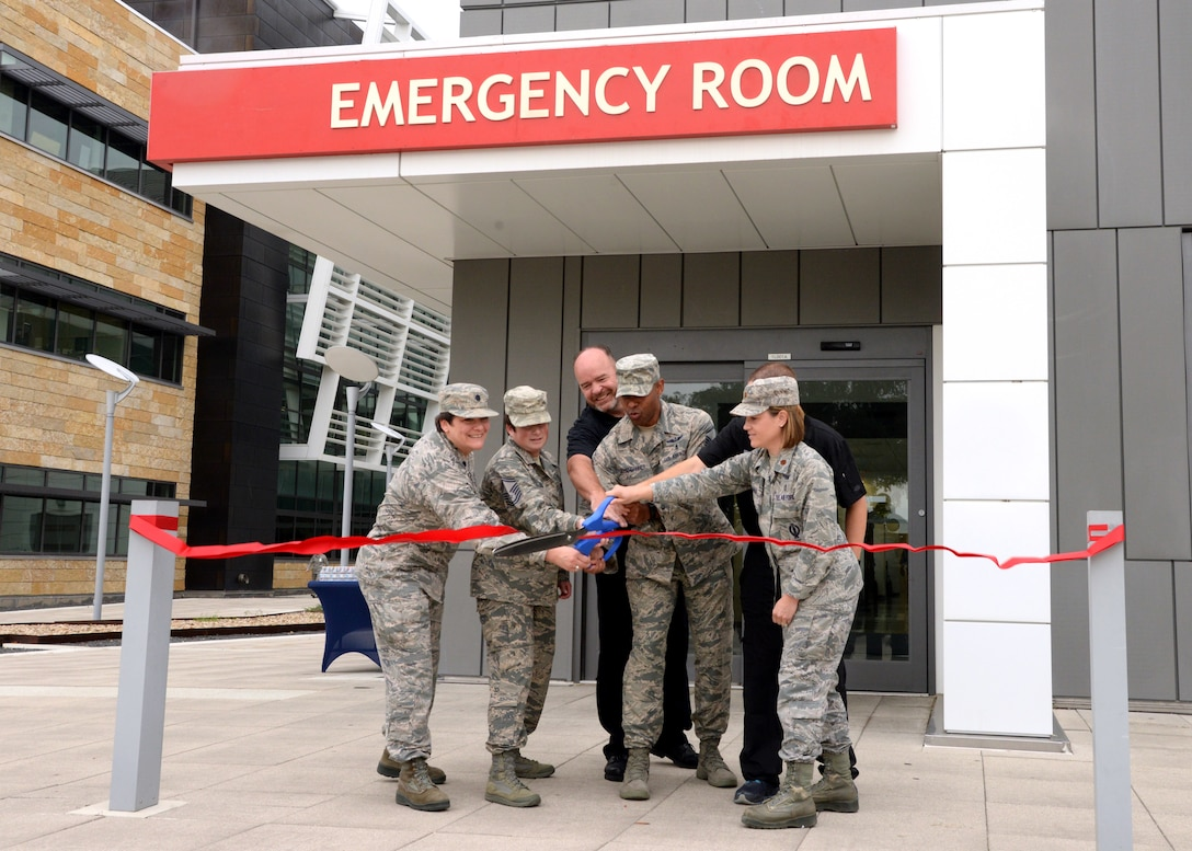 59th Medical Wing personnel cut the ribbon to officially transition the Urgent Care Clinic to a Family Emergency Center on Oct. 1, at Wilford Hall Ambulatory Surgical Center on Joint Base San Antonio-Lackland, Texas. The FEC will provide 24-hour emergency care to all Tricare beneficiaries in the San Antonio area who would have been previously transferred to local facilities. (U.S. Air Force photo by Daniel J. Calderón)