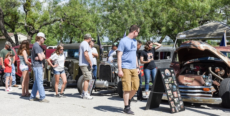 Members of Goodfellow Air Force Base and the San Angelo community observe the competition at the 19th Annual Goodfellow Air Force Base Car and Motorcycle Show during the Ruckus at the Rec Camp event at the Goodfellow Recreation Camp, San Angelo, Texas, Sept. 29, 2018. The car and motorcycle show was one event during the Ruckus at the Rec Camp there was also a barbeque and chili cook-off, ending with a concert. (U.S. Air Force photo by Aryn Lockhart/Released)