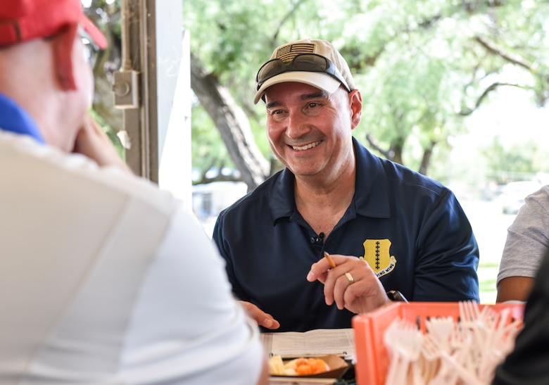 U.S. Air Force Col. Robert Ramirez, 17th Training Wing vice commander, laughs with fellow judges at the 44th Annual Armed Forces International Terlingua Chili Cook-Off during the Ruckus at the Rec Camp event at Goodfellow Air Force Base Recreation Camp, San Angelo, Texas, Sept. 29, 2018. The judges blind tasted over 20 different Terlingua chili during the cook-off. (U.S. Air Force photo by Aryn Lockhart/Released)